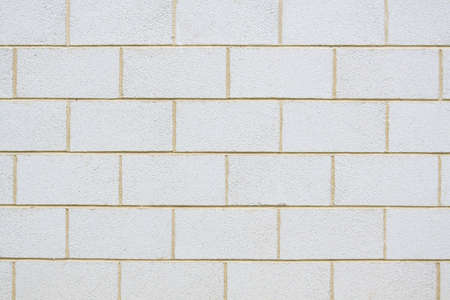 A plain breeze block wall for use as background photo