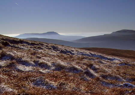 fells: Haze on nearby Fells from Great Knoutberry Hill, Cowgill, Cumbria, UK Stock Photo