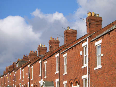 row of red-brick terraced houses photo