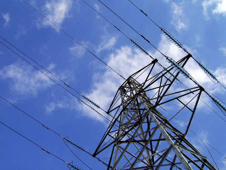 eyesore: electricity pylon  tower with fluffy white clouds and blue sky background