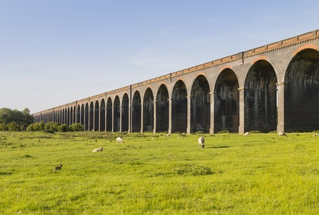 man made structure: Harringworth railway viaduct showing a selection of the eighty two arches. Northamptonshire England. Stock Photo
