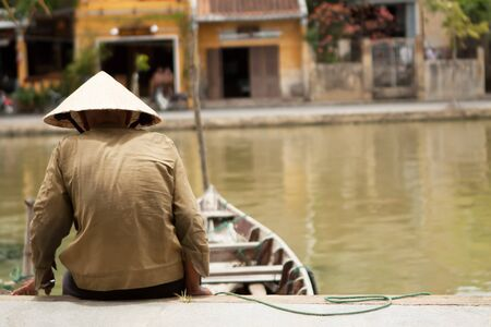 conical hat: Vietnamese fisherman with his boat wearing a conical hat
