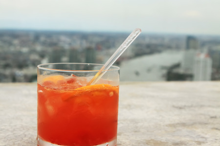 fruity: Fruity cocktail with Bangkok city in the background from the Lebua Hotel in Thailand