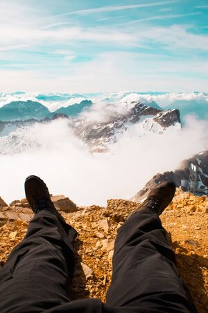 mountain peek: Picture of a walkers legs with a beautiful back drop of the Austrian Alps Stock Photo
