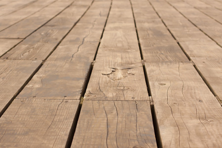 going for it: Wooden Decking on a Pier with a Symbol of a Fish