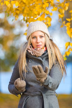 self defence: Young woman practising self defence outdoor in autumn