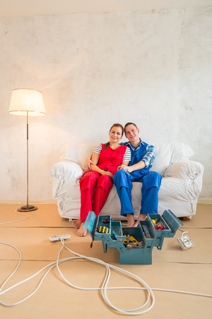 redecoration: Happy young couple  in the middle of renovation.