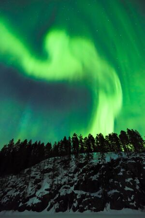 geomagnetic: Colorful Northern lights Aurora borealis in the sky