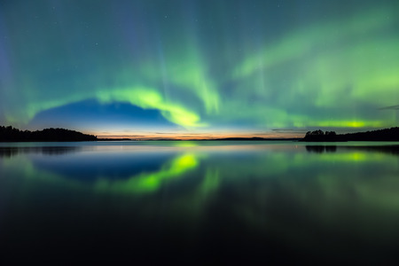 Colorful Northern lights Aurora borealis in the sky Фото со стока - 48599192