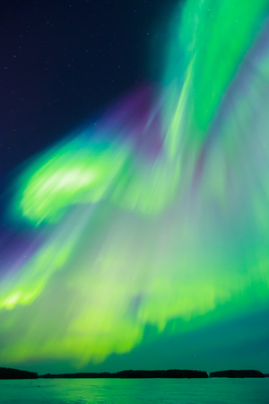 sunspot: Colorful Northern lights (Aurora borealis) in the sky Stock Photo