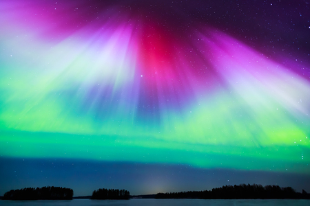 Colorful Northern lights Aurora borealis in the sky Фото со стока - 48597640