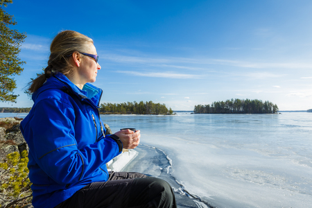 woman middle age: Middle age woman on lake side in winter Stock Photo