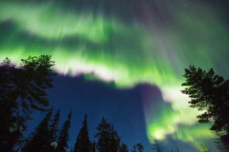 geomagnetic: Colorful Northern lights (Aurora borealis) in the sky Stock Photo