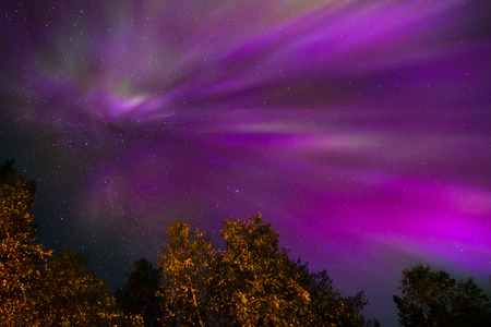 sunspot: Colorful Northern lights Crown (Aurora borealis) in the sky Stock Photo
