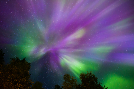 Colorful Northern lights Crown (Aurora borealis) in the sky Stock Photo