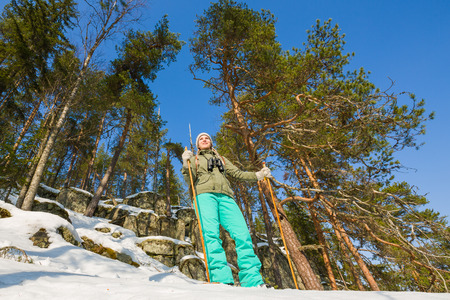 snowshoes: Young beautiful woman with snowshoes chill out and relax in the forest Stock Photo