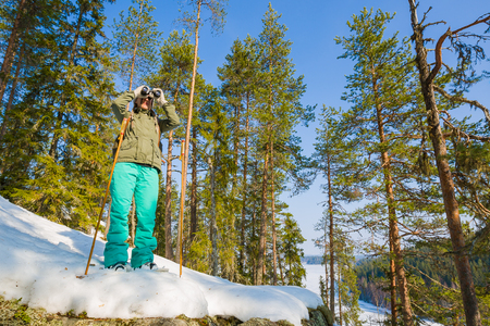 Young beautiful woman with snowshoes chill out and relax in the forest Фото со стока