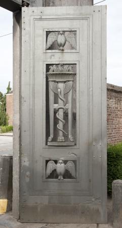 symbolism: symbolism on belgian cemetery gate Stock Photo