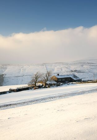 yorkshire dales winter farmhouse in snow photo
