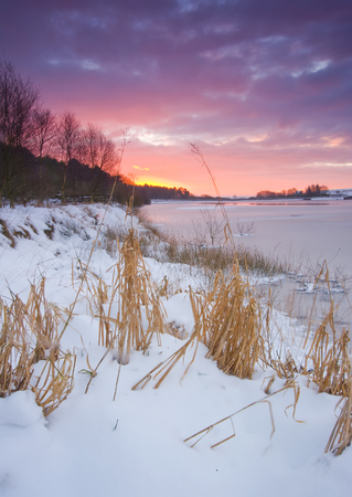 ice dam: winter sunrise at yorkshire reservoir