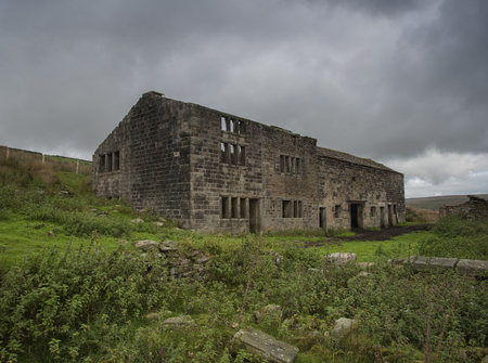 blustery: derelict farmhouse on yorkshire moors Stock Photo