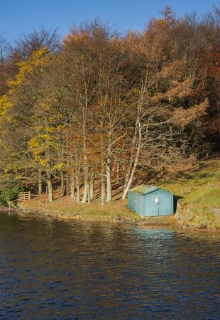 fishing hut: autumn reservoir and fishing hut