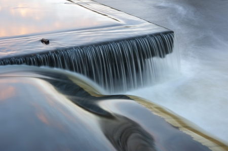 hindrance: flowing water cascading over a weir on yorkshire river