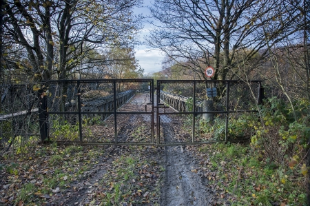 road and path through: fenced road bridge Stock Photo