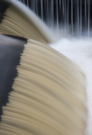 sluice: flowing water cascading over a weir on yorkshire river