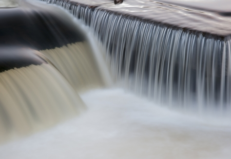culvert: flowing water cascading over a weir on yorkshire river