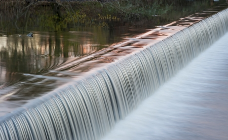 weir: river weir with motion blurred water falling over