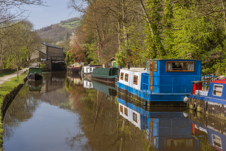 moorings: Canal narrowboats at the moorings close to the west Yorkshire town of Hebden Bridge, Calderdale. Stock Photo