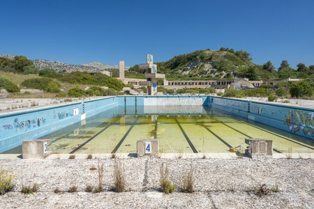 putrid: an abandoned lido complex on the island of rhodes in Greece where the swimming pools have filled with rain water and tuend green with algae