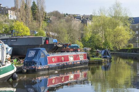 moorings: Narrowboats moored alongside the towpath of the Moorings at Sowerby Bridge in Calderdale West Yorkshire