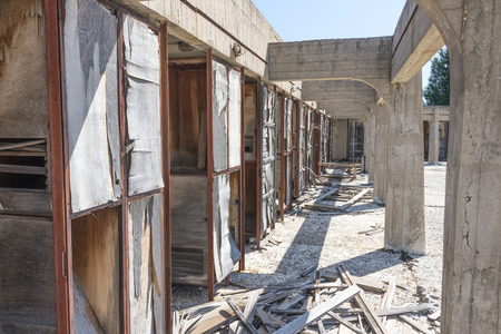 lido: A row of ruined changing rooms at an abandoned lido on the Greek island of Rhodes.