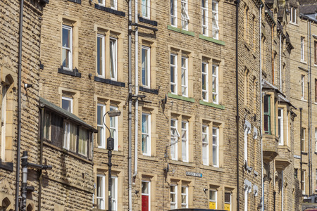 rambling: The pretty tourist town of Hebden Bridge in the South Pennine region of West Yorkshire showing steep terraced houses on the surrounding hillside Stock Photo