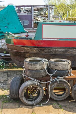 dumped: Vehicle tyres dumped in a boatyard alongside an abandone narrowboat