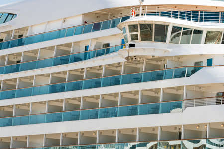 starboard: Empty balconies on the starboard side of a cruise liner moored at the tourist harbour of the Greek island of Rhodes. Stock Photo