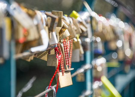 vows: Padlocks inscribed with couples vows of love attached to a bridge in Bakewell, Derbyshire Stock Photo