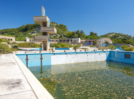lido: an abandoned lido complex on the island of rhodes in Greece where the swimming pools have filled with rain water and tuend green with algae