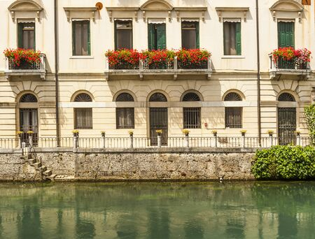 apertures: Typical venetian architecture along the streets of the Italian town of Treviso in the Northern region of Veneto. Stock Photo