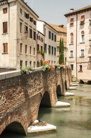 Typical venetian architecture along the streets of the Italian town of Treviso in the Northern region of Veneto. Stock Photo