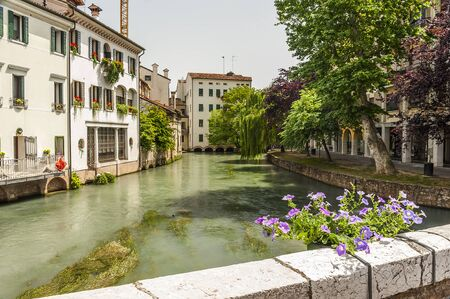 treviso: Typical venetian architecture along the streets of the Italian town of Treviso in the Northern region of Veneto. Stock Photo