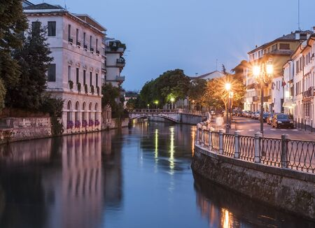 Early evening along the banks of the river sile in the Veneto town of Treviso in northern Italy Stock Photo