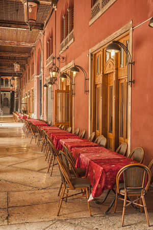 treviso: tables and chairs lined up outside of a restaurant in the Italian town of Treviso in the Veneto region.