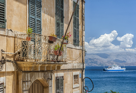A view of a ferry taken from an elevated position in a venetian building on the Greek island of Corfu in the Ionian sea..