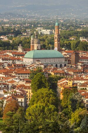 dominating: View towards the Italian of Vicenza with the impressive basilica palladiana dominating the skyline
