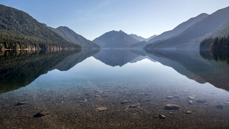 crescent lake: Crescent Lake reflection in Olympic National Park Stock Photo