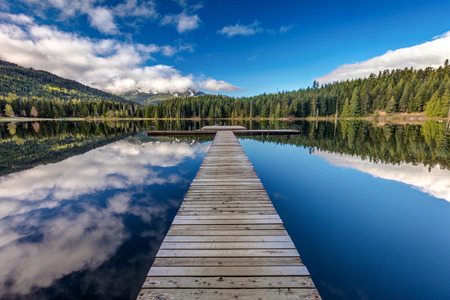 Long dock at Lost Lake in Whistler,BC 版權商用圖片 - 106363821