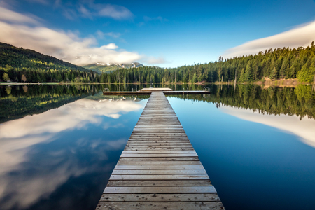 the Dock at lost lake on a calm morning in Whistler, British Columbia, Canada